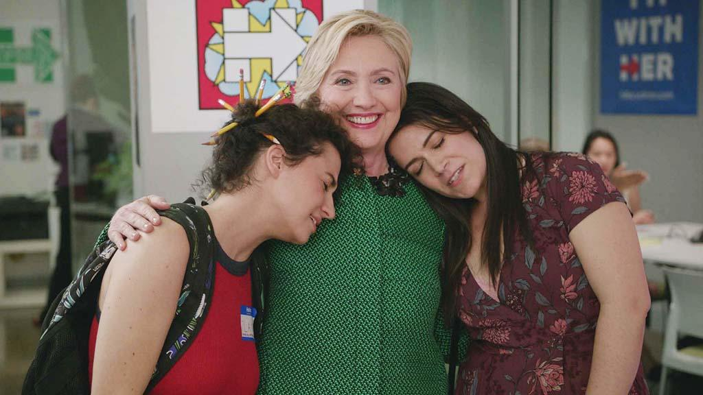 <p>The presidential candidate made a brief, but shining cameo on the show after Ilana landed a job with the campaign. Ilana attempted to cold-call voters, but soon learned this was a nonpaying gig. And just as she and Abbi were about to leave the office, in sailed HRC. The two totally lost their minds and even got a hug. #BroadsWithHer. —<em>KW</em><br />(Photo: Comedy Central) </p>