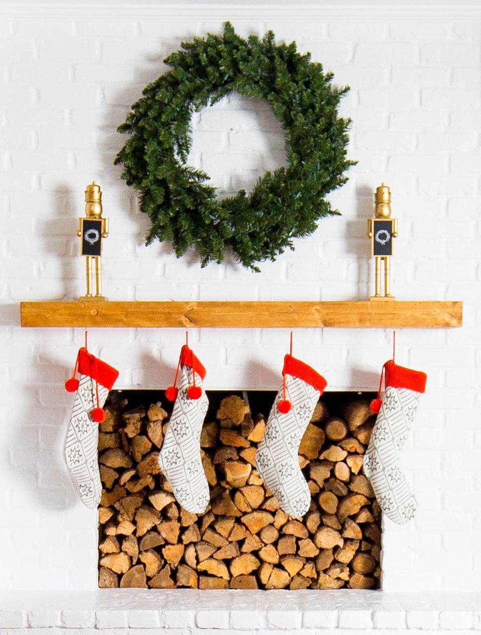 "<p>Keep it simple and flank your mantel with two tiny toy soldiers or nutcrackers. Anchor it with a statement wreath in the middle.</p><p>See more at <a href=""https://sugarandcloth.com/holiday-living-room-makeover-we-gifted-with-lowes/"" rel=""nofollow noopener"" target=""_blank"" data-ylk=""slk:Sugar & Cloth"" class=""link rapid-noclick-resp"">Sugar & Cloth</a>.</p>"