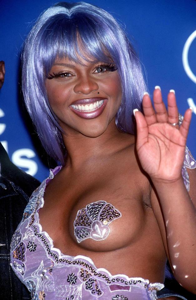 """<p>At the 1999 MTV Video Music Awards, rapper Lil' Kim's mermaid catsuit and sequin pasties weren't the only things that got everyone's attention. </p><p>""""If you're seeking a sexy, yet subtle, hair color for a dark-brown skin tone, try purple,"""" says Omari. """"The dark brown to black base keeps your hairstyle grounded, and adding a touch of purple accents your overall look. This color will bring out your natural features and beautiful brown skin, making your eyes look bigger and brighter.""""</p>"""