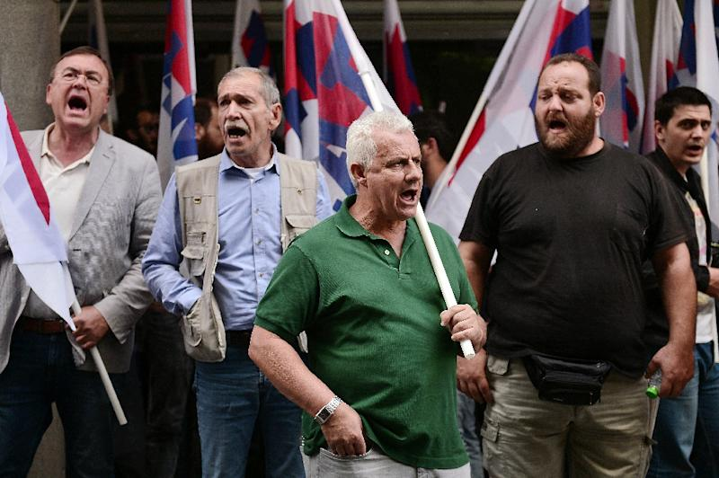 Communist-affiliated PAME workers union protesters block the entrance to the finance ministry in Athens on June 11, 2015 (AFP Photo/Louisa Gouliamaki)