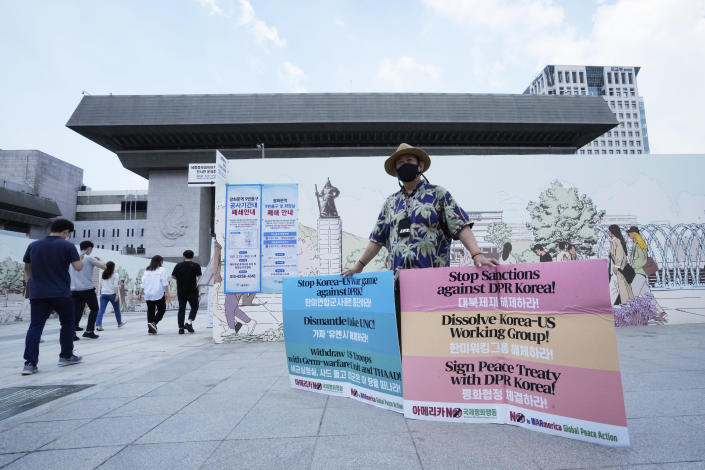 A protester stands to denounce policies of the United States on North Korea near the U.S. Embassy in Seoul, South Korea, Monday, June 21 2021. U.S. President Joe Biden's special envoy for North Korea said Monday he hopes to see a positive reaction from the North soon on U.S. offers for talks after the North Korean leader ordered officials to prepare for both dialogue and confrontation. (AP Photo/Ahn Young-joon)