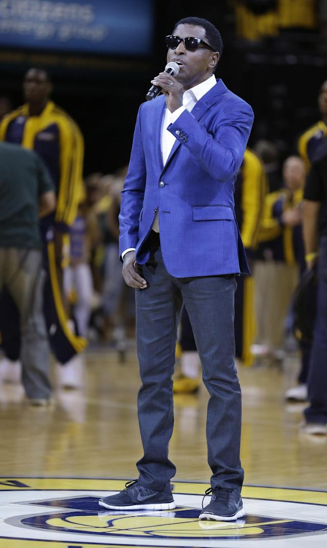 """Kenneth """"Babyface"""" Edmonds sings the U.S. national anthem before Game 5 of the NBA basketball playoffs Eastern Conference finals between the Indiana Pacers and the Miami Heat, in Indianapolis on Wednesday, May 28, 2014. (AP Photo/Michael Conroy)"""