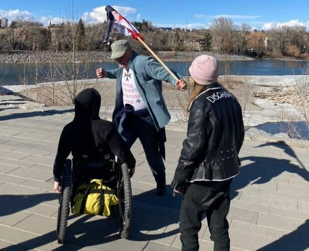 The confrontation occurred after a rally against COVID-19 public health restrictions on Prince's Island in downtown Calgary on March 20. (@TaylorMadeYYC/Twitter - image credit)