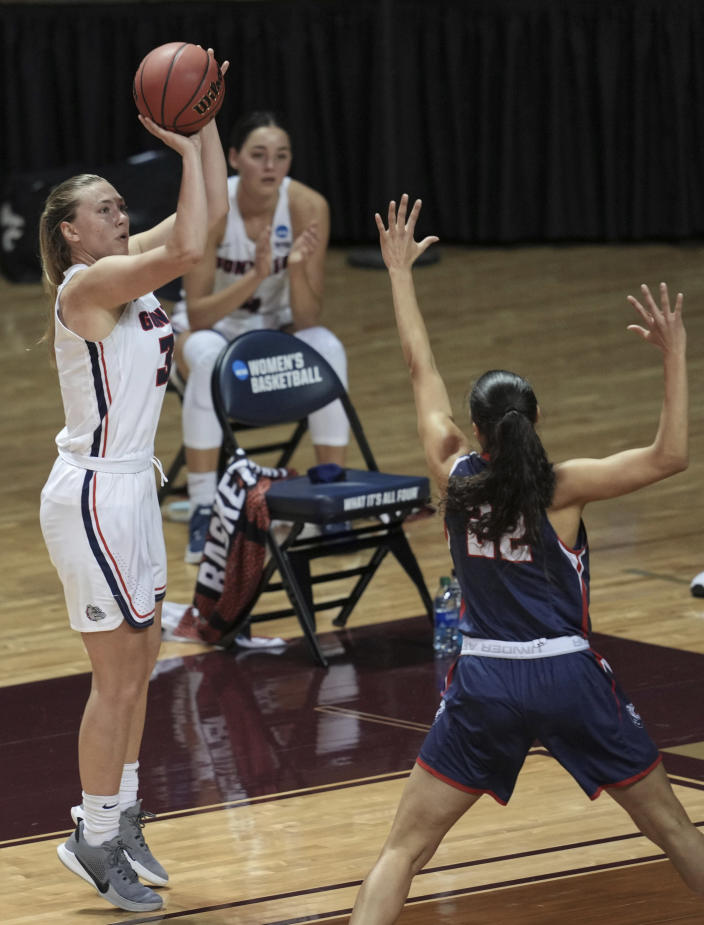 Gonzaga's Jill Townsend shoots as Belmont's Maddie Cook (22) defends during the second half of a college basketball game in the first round of the NCAA women's tournament at University Events Center in San Marcos, Texas, Monday, March 22, 2021. (AP Photo/Chuck Burton)