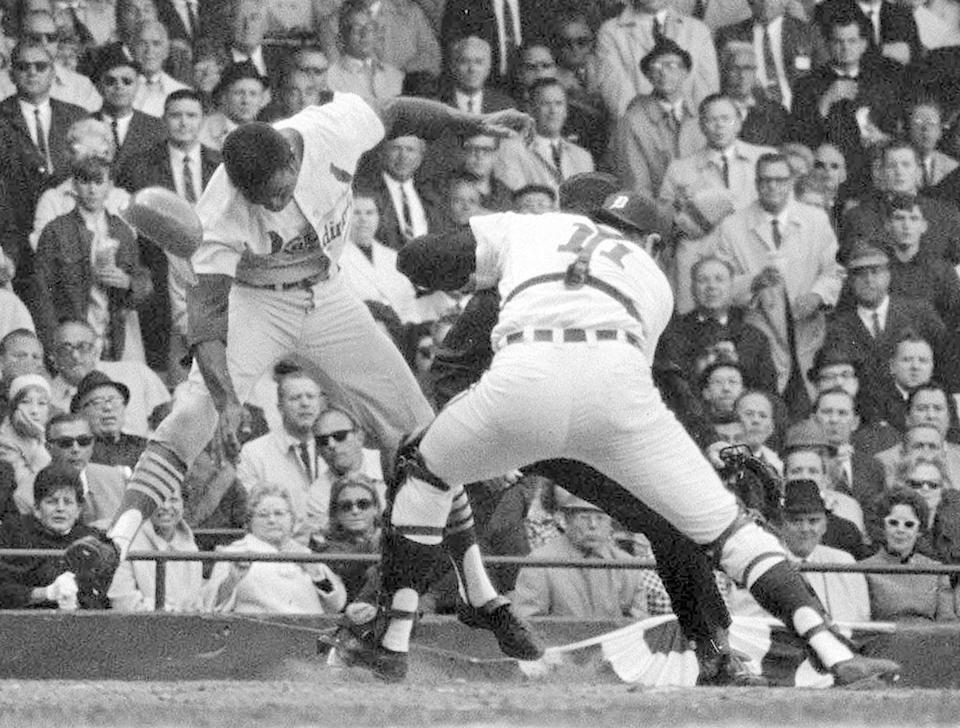 """FILE - St. Louis Cardinals' Lou Brock is tagged out by Bill Freehan of the Detroit Tigers in fifth inning of the fifth game of the World Series at Detroit's Tiger Stadium, in this Oct. 7, 1968, file photo. Tigers outfielder Willie Horton made the throw to put out the speedy Brock at the plate. Freehan, an 11-time All-Star catcher with the Detroit Tigers and key player on the 1968 World Series championship team, has died at age 79. """"It's with a heavy heart that all of us with the Detroit Tigers extend our condolences to the friends and family of Bill Freehan,"""" the team said Thursday, Aug. 19, 2021. (AP Photo/File)"""