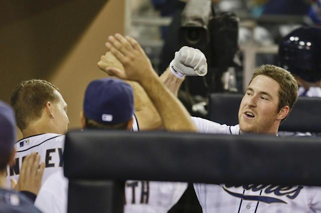 San Diego Padres' Jedd Gyorko, right, bangs forearms with Nick Hundley after hitting a home run in the fifth inning of a baseball game against the Los Angeles Dodgers on Friday, Sept. 20, 2013, in San Diego. (AP Photo/Lenny Ignelzi)