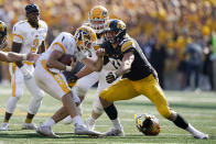 Kent State quarterback Dustin Crum (7) is sacked by Iowa linebacker Jack Campbell (31) during the first half of an NCAA college football game, Saturday, Sept. 18, 2021, in Iowa City, Iowa. (AP Photo/Charlie Neibergall)