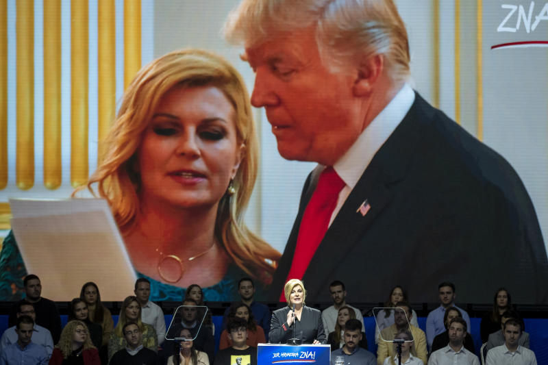 In this Thursday, Dec.19, 2019, file photo, under displayed photo of meeting president Trump, presidential candidate Kolinda Grabar Kitarovic addresses supporters at a rally in Zagreb, Croatia. Croatia's bitterly contested presidential race is headed for a finale this weekend to decide whether a conservative or a liberal will lead the country during its first ever chairmanship over the European Union. (AP Photo/Darko Bandic, File)