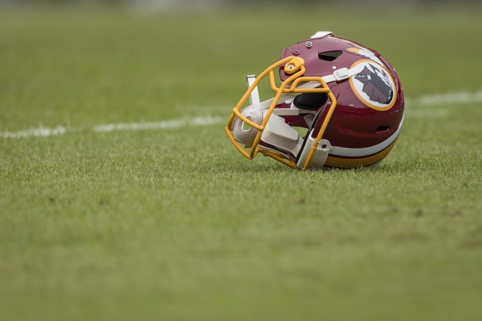 LANDOVER, MD - OCTOBER 06: A Washington Redskins helmet is seen on the field before the game between the Washington Redskins and the New England Patriots at FedExField on October 6, 2019 in Landover, Maryland. (Photo by Scott Taetsch/Getty Images)