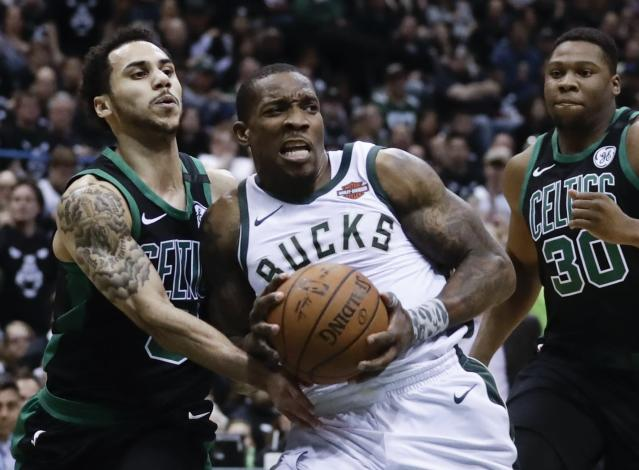 Milwaukee Bucks' Eric Bledsoe is fouled by Boston Celtics' Shane Larkin during the first half of Game 4 of an NBA basketball first-round playoff series Sunday, April 22, 2018, in Milwaukee. (AP Photo/Morry Gash)