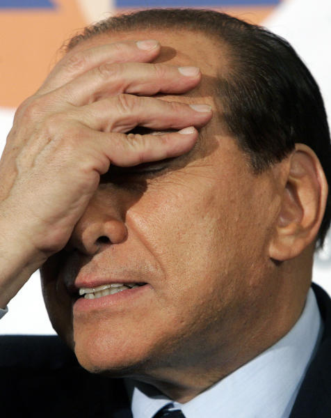 FILE - In this Oct. 6, 2005 file photo, Italian Premier Silvio Berlusconi touches his face during a joined press conference in Rome. On Thursday, March 7, 2013 a Milan court convicted former Premier Silvio Berlusconi for the illegal publication of transcripts of wiretapped conversations in a newspaper owned by his media empire. The court on Thursday sentenced him to one year in jail, although in Italy a sentence is not carried out on the first level of justice unless the crime is grave. Berlusconi can appeal the sentence. (AP Photo/Pier Paolo Cito , File)