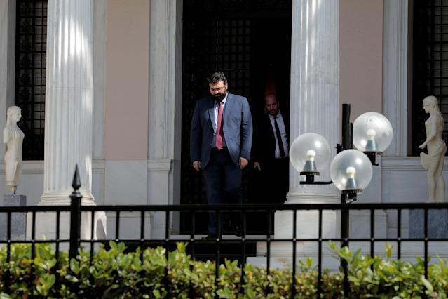 Deputy Culture and Sports Minister Georgios Vassiliadis (C) exits the Maximos Mansion, following a meeting with Greek Prime Minister Alexis Tsipras in Athens, Greece, March 12, 2018. REUTERS/Alkis Konstantinidis