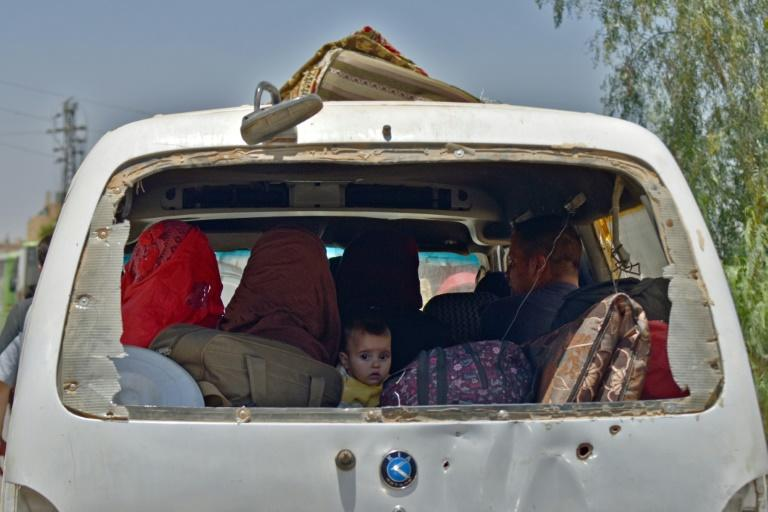 Displaced Syrians from the Daraa province come back to their hometown in Bosra, southwestern Syria, on July 11, 2018
