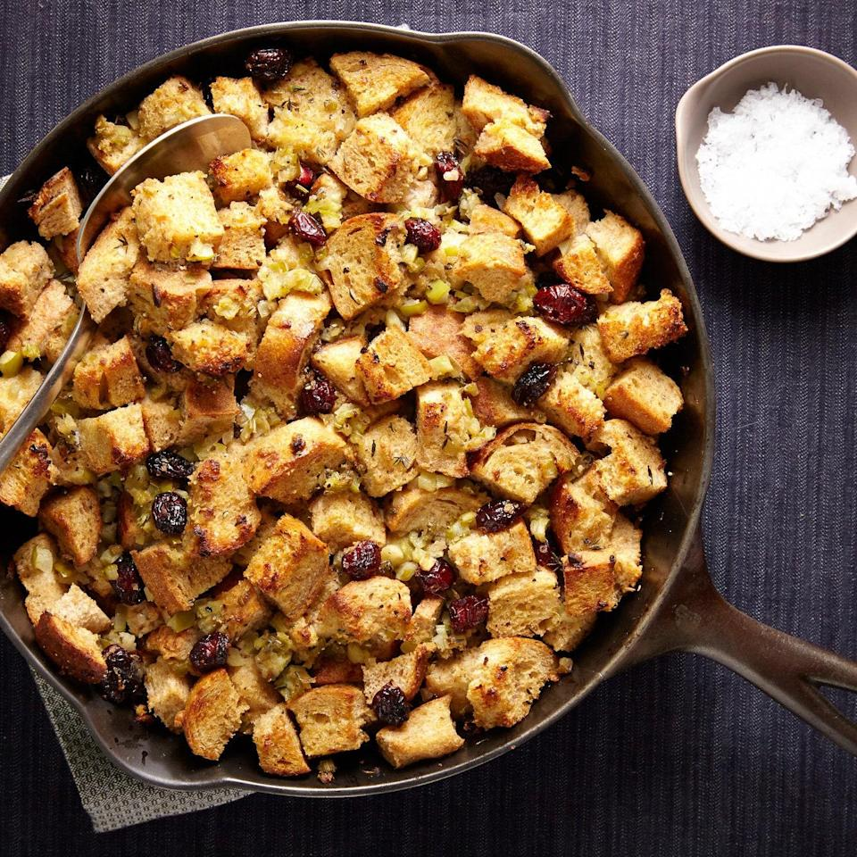 """Cooking your stuffing in an ovenproof skillet means it can go from stove to oven without missing a beat. Prepping the aromatic vegetables in the food processor cuts down on chopping time, too. <a href=""""https://www.epicurious.com/recipes/food/views/skillet-stuffing-with-apples-shallots-and-cranberries-51258440?mbid=synd_yahoo_rss"""" rel=""""nofollow noopener"""" target=""""_blank"""" data-ylk=""""slk:See recipe."""" class=""""link rapid-noclick-resp"""">See recipe.</a>"""
