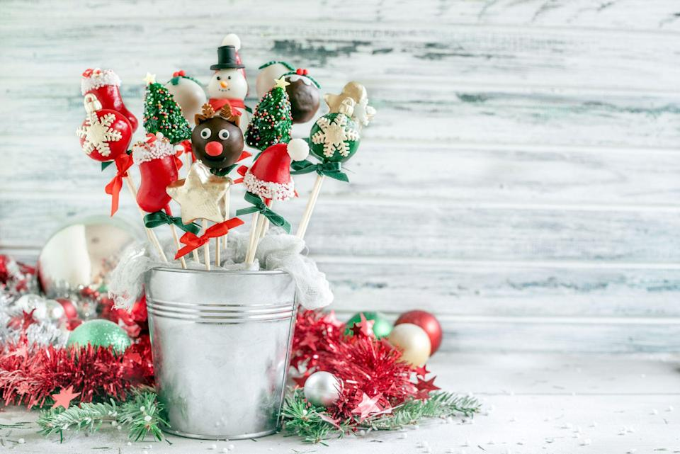 """<p>When it comes to baking up sweet homemade treats, there's really no time like Christmas to bring out the baker in all of us. And the thing is, there are a <em>lot</em> of <a href=""""https://www.countryliving.com/food-drinks/g1036/easy-christmas-desserts/"""" rel=""""nofollow noopener"""" target=""""_blank"""" data-ylk=""""slk:Christmas desserts"""" class=""""link rapid-noclick-resp"""">Christmas desserts</a> to choose between when planning out your holiday baking schedule. Obviously, you have to make a batch or two of <a href=""""https://www.countryliving.com/food-drinks/g647/holiday-cookies-1208/"""" rel=""""nofollow noopener"""" target=""""_blank"""" data-ylk=""""slk:holiday cookies"""" class=""""link rapid-noclick-resp"""">holiday cookies</a> (at least, you do if Santa has any say in the matter), but after that the sky's the limit: You can make <a href=""""https://www.countryliving.com/food-drinks/g2806/best-christmas-cakes/"""" rel=""""nofollow noopener"""" target=""""_blank"""" data-ylk=""""slk:Christmas cakes"""" class=""""link rapid-noclick-resp"""">Christmas cakes</a>, you can make <a href=""""https://www.countryliving.com/home-design/decorating-ideas/g310/good-enough-to-eat-1206/"""" rel=""""nofollow noopener"""" target=""""_blank"""" data-ylk=""""slk:gingerbread houses"""" class=""""link rapid-noclick-resp"""">gingerbread houses</a> (or dozens of other <a href=""""https://www.countryliving.com/food-drinks/g2741/gingerbread-dessert-recipes/"""" rel=""""nofollow noopener"""" target=""""_blank"""" data-ylk=""""slk:gingerbread recipes"""" class=""""link rapid-noclick-resp"""">gingerbread recipes</a>), you can make pies, and even creative <a href=""""https://www.countryliving.com/food-drinks/g2754/eggnog-dessert-and-cocktail-recipes/"""" rel=""""nofollow noopener"""" target=""""_blank"""" data-ylk=""""slk:eggnog recipes"""" class=""""link rapid-noclick-resp"""">eggnog recipes</a>. So while Christmas cake pops might not at be at the top of your to-do list, allow us to present you with a variety of reasons while they deserve a spot on your dessert spread. </p><p>Cleanup is easy, for starters, because there won't be any forks or plates """