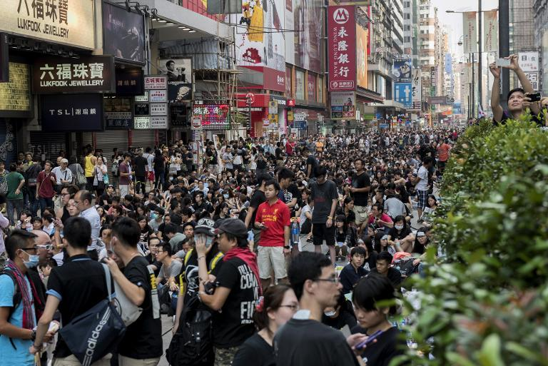 Pro-democracy protesters block off a major road in the Kowloon district of Hong Kong on September 29, 2014