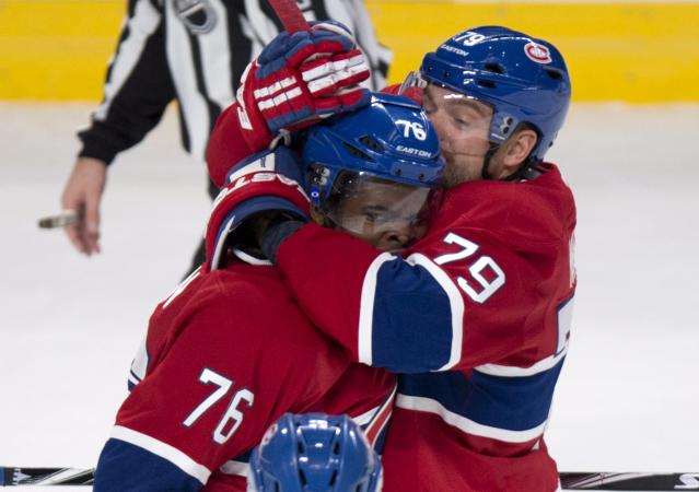 Montreal Canadiens' P.K. Subban (76) is hugged by teammate Andrei Markov (79) after scoring against the Toronto Maple Leafs during the first period of an NHL hockey game Saturday, Nov. 30, 2013 in Montreal. (AP Photo/The Canadian Press, Paul Chiasson)