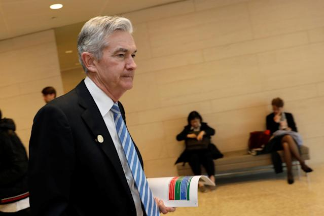 Federal Reserve Chairman Jerome Powell leaves after IMFC plenary the IMF/World Bank spring meeting in Washington, U.S., April 20, 2018. REUTERS/Yuri Gripas