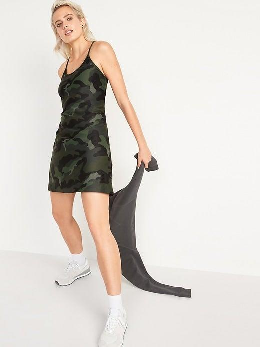 """<h2>Best Affordable<br></h2><br><h3>Old Navy Sleeveless PowerSoft Performance Racer-Back Swing Dress<br></h3><br>Camo print meets cool with this racerback A-line dress with extra stretch. (In other words, you won't want to take it off.)<br><br><strong>What They're Saying:</strong> """"This doesn't have the built-in shorts like other brands' version of this dress, but I almost like that better for bathroom purposes. Probably will be purchasing a second one because I could wear this every day.""""<br><br><strong>Old Navy</strong> Sleeveless PowerSoft Performance Racer-Back Swing Dress, $, available at <a href=""""https://go.skimresources.com/?id=30283X879131&url=https%3A%2F%2Foldnavy.gap.com%2Fbrowse%2Fproduct.do%3Fpid%3D691779002%26pcid%3D999%26vid%3D1%23pdp-page-content"""" rel=""""nofollow noopener"""" target=""""_blank"""" data-ylk=""""slk:Old Navy"""" class=""""link rapid-noclick-resp"""">Old Navy</a>"""