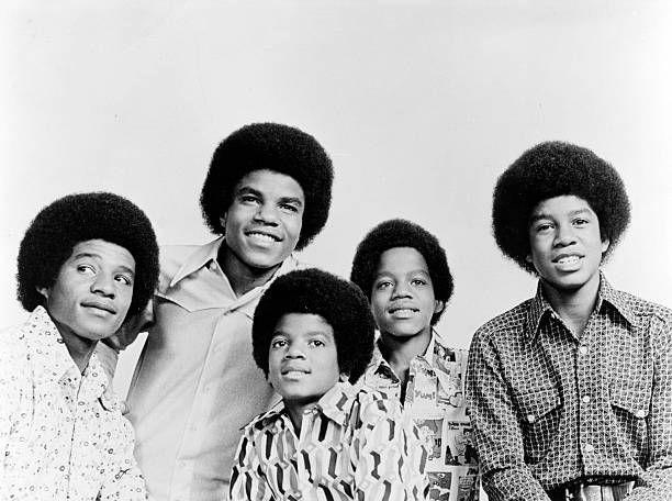 """<p>Long before Michael Jackson was a worldwide sensation, he and his brothers attained an amazing degree of fame as kids. Raised in Gary, Indiana, the five brothers, ranging in age from 17 to 10, offered a wholesome family group with upbeat pop music—much different from a lot of the folksy songs that were currently in favor. Pushed by their musician father, The Jackson Five first played nightclubs, eventually catching the eye of producer Berry Gordy, Junior. They rocketed to fame in 1970, with their first four singles hitting the top of the charts: <a href=""""https://www.amazon.com/I-Want-You-Back/dp/B001NCUPG8/?tag=syn-yahoo-20&ascsubtag=%5Bartid%7C10063.g.35225069%5Bsrc%7Cyahoo-us"""" rel=""""nofollow noopener"""" target=""""_blank"""" data-ylk=""""slk:&quot;I Want You Back&quot;"""" class=""""link rapid-noclick-resp"""">""""I Want You Back""""</a>, <a href=""""https://www.amazon.com/ABC/dp/B001NCKTRS/?tag=syn-yahoo-20&ascsubtag=%5Bartid%7C10063.g.35225069%5Bsrc%7Cyahoo-us"""" rel=""""nofollow noopener"""" target=""""_blank"""" data-ylk=""""slk:&quot;ABC&quot;"""" class=""""link rapid-noclick-resp"""">""""ABC""""</a>, <a href=""""https://www.amazon.com/The-Love-You-Save/dp/B001NCMLPG/?tag=syn-yahoo-20&ascsubtag=%5Bartid%7C10063.g.35225069%5Bsrc%7Cyahoo-us"""" rel=""""nofollow noopener"""" target=""""_blank"""" data-ylk=""""slk:&quot;The Love You Save&quot;"""" class=""""link rapid-noclick-resp"""">""""The Love You Save""""</a> and <a href=""""https://www.amazon.com/Ill-Be-There/dp/B001NCRBG0/?tag=syn-yahoo-20&ascsubtag=%5Bartid%7C10063.g.35225069%5Bsrc%7Cyahoo-us"""" rel=""""nofollow noopener"""" target=""""_blank"""" data-ylk=""""slk:&quot;I'll Be There&quot;"""" class=""""link rapid-noclick-resp"""">""""I'll Be There""""</a>. Over the next two years, seven more singles would hit the top 25.</p>"""
