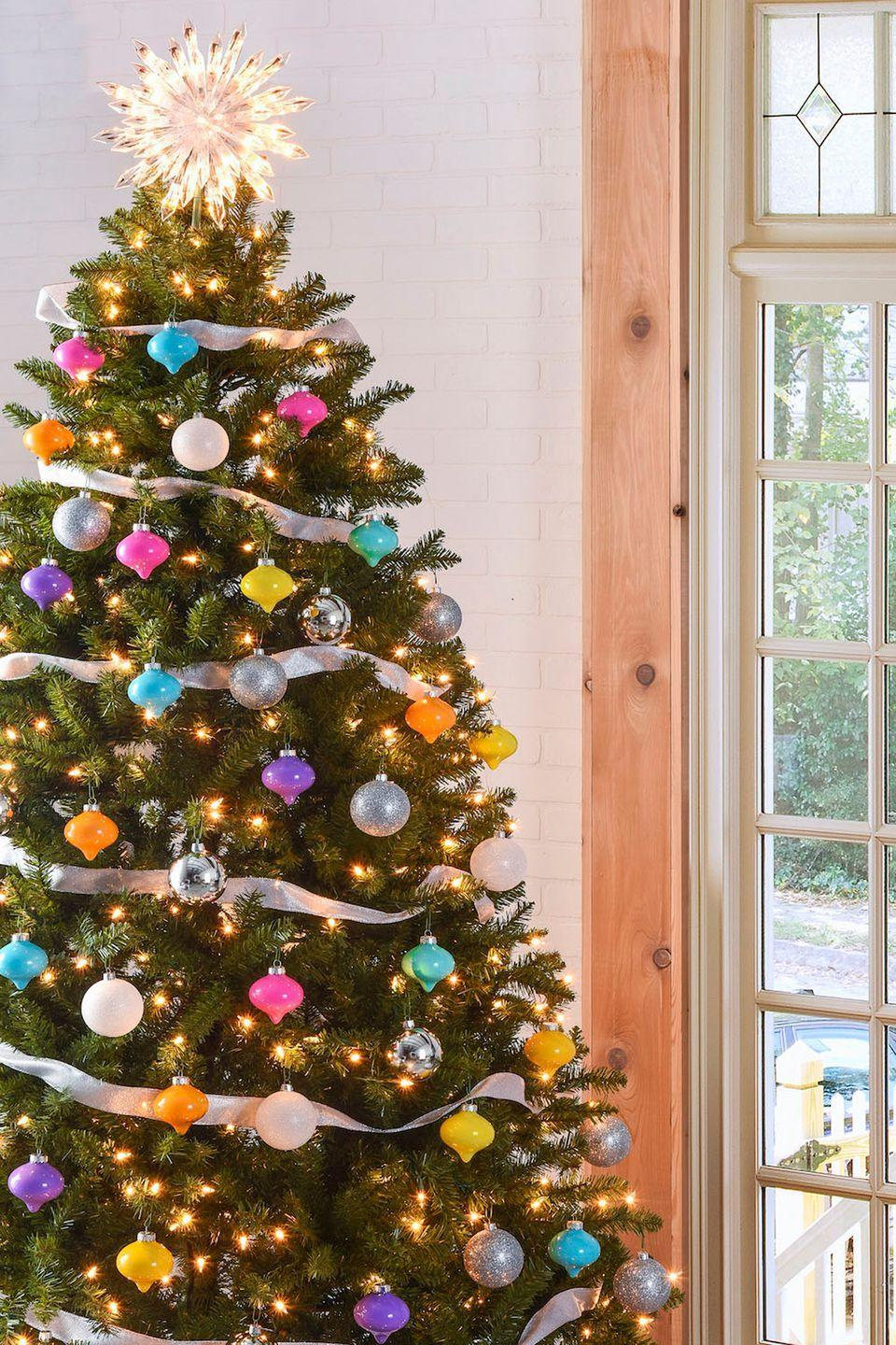 """<p>Create this simple and fun candy-colored DIY look with clear ornaments from your local craft store and some acrylic paint of your choice. </p><p><strong><em>Get the tutorial at <a href=""""http://modpodgerocksblog.com/2015/11/colorful-vintage-inspired-christmas-tree.html"""" rel=""""nofollow noopener"""" target=""""_blank"""" data-ylk=""""slk:Mod Podge Rocks"""" class=""""link rapid-noclick-resp"""">Mod Podge Rocks</a>.</em></strong></p><p><a class=""""link rapid-noclick-resp"""" href=""""https://www.amazon.com/Creative-Hobbies-Ornament-3-15-Inch-Diameter/dp/B00G6RJ75A/?tag=syn-yahoo-20&ascsubtag=%5Bartid%7C10070.g.2025%5Bsrc%7Cyahoo-us"""" rel=""""nofollow noopener"""" target=""""_blank"""" data-ylk=""""slk:BUY CLEAR ORNAMENTS"""">BUY CLEAR ORNAMENTS</a> </p>"""