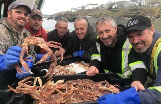 Members of the crew of the Eastern Princess II are all smiles are they pose for a photograph with some of the valuable catch they landed at Port de Grave this week. They are, from left, Jonathan Boone, Chris Butler, Shane Lynch, Derrick Petten, Nelson Bussey and Wayde Gillingham.