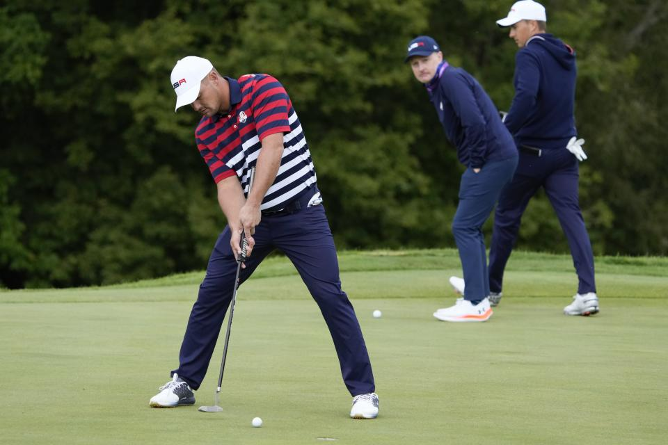 Team USA's Bryson DeChambeau putts on the ninth green during a practice day at the Ryder Cup at the Whistling Straits Golf Course Thursday, Sept. 23, 2021, in Sheboygan, Wis. (AP Photo/Ashley Landis)