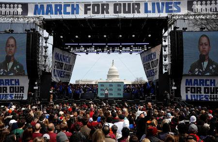 "FILE PHOTO: Emma Gonzalez, a student and shooting survivor from the Marjory Stoneman Douglas High School in Parkland, Florida, addresses the conclusion of the ""March for Our Lives"" event demanding gun control after recent school shootings at a rally in Washington, U.S., March 24, 2018. REUTERS/Aaron P. Bernstein/File Photo"