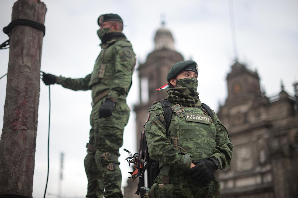 VARIOUS CITIES, MEXICO - SEPTEMBER 16: Mexican soldiers look on during the Independence Day military parade at Zocalo Square on September 16, 2020 in Various Cities, Mexico. This year El Zocalo remains closed for general public due to coronavirus restrictions. Every September 16 Mexico celebrates the beginning of the revolution uprising of 1810. (Photo by Hector Vivas/Getty Images)