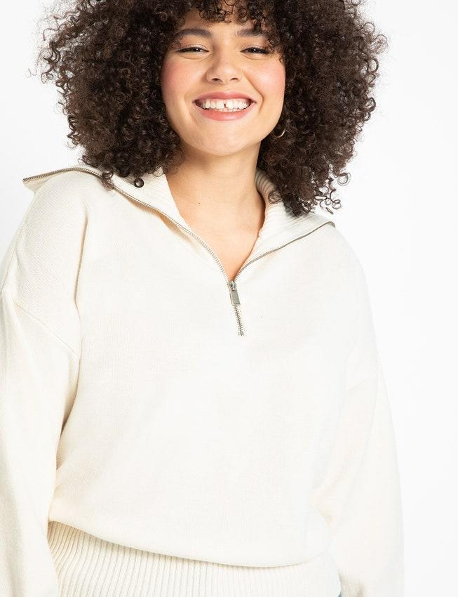 "Snap up this cream cutie, stat. It has an oversized collar, and the ribbed waistband gives structure to the otherwise boxy fit. $64.95, Eloquii. <a href=""https://www.eloquii.com/half-zip-sweater/1083053.html"" rel=""nofollow noopener"" target=""_blank"" data-ylk=""slk:Get it now!"" class=""link rapid-noclick-resp"">Get it now!</a>"