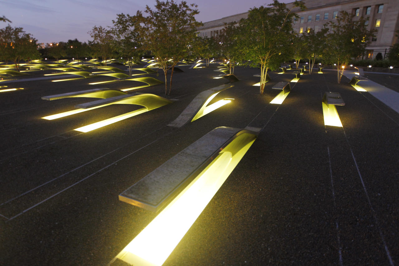 Lights illuminate the 184 stone benches outside the Pentagon in Arlington, Va. Each bench bears the name of a person who died Sept. 11, 2001, in the terrorist attack on the Pentagon and together comprise the permanent outdoor Pentagon Memorial, created to honor the family members and friends killed both in the building and on American Airlines Flight 77. The Pentagon was the first of the three attack sites to open an official memorial. It was dedicated Sept. 11, 2008, and is open 24 hours a day, 365 days a year. (AP Photo/Jose Luis Magana)