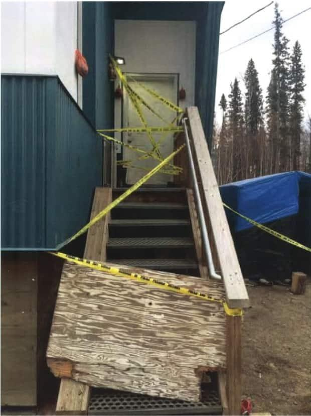 The door to the house where Danny Klondike and Selena Lomen were living in Fort Liard. (Court documents - image credit)