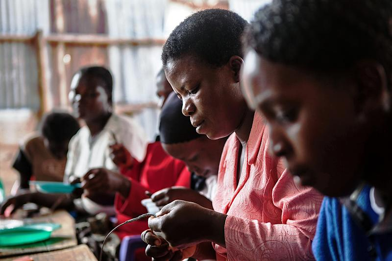 Women work in Nairobi's Korogocho slum creating clothes and accessories for Ethical Fashion Africa, a not-for-profit group, June 19, 2014 (AFP Photo/Nichole Sobecki)