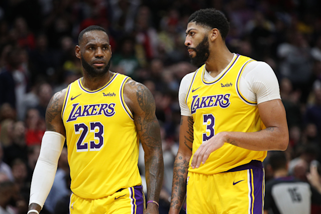 "Lakers teammates LeBron James, left, and Anthony Davis got a sneak peak at some of the new features that will be on display in the arena where they'll be playing games in Orlando. <span class=""copyright"">(Chris Graythen / Getty Images)</span>"