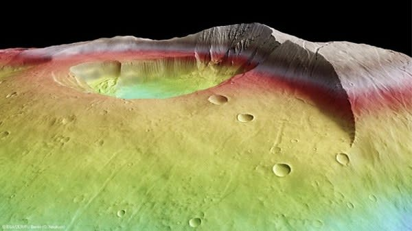 Over the course of billions of years, Tharsis Tholus has become dotted with the scars of small to medium-sized impacts from space debris. The mountain is in an advanced state of erosion, making it particularly interesting to scientists looking to study the history of the red planet. Image Credit: ESA/DLR/FU Berlin (G. Neukum). Photo courtesy of Tecca