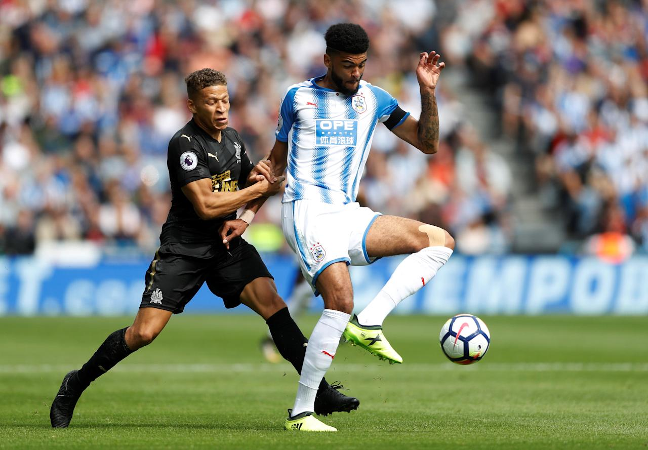 "Football Soccer - Premier League - Huddersfield Town vs Newcastle United - Huddersfield, Britain - August 20, 2017   Newcastle United's Dwight Gayle in action with Huddersfield Town's Philip Billing   Action Images via Reuters/Carl Recine    EDITORIAL USE ONLY. No use with unauthorized audio, video, data, fixture lists, club/league logos or ""live"" services. Online in-match use limited to 45 images, no video emulation. No use in betting, games or single club/league/player publications. Please contact your account representative for further details."