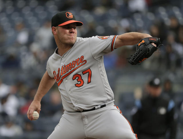 Baltimore Orioles pitcher Dylan Bundy throws during the first inning of a baseball game against the New York Yankees at Yankee Stadium, Sunday, March 31, 2019, in New York. (AP Photo/Seth Wenig)