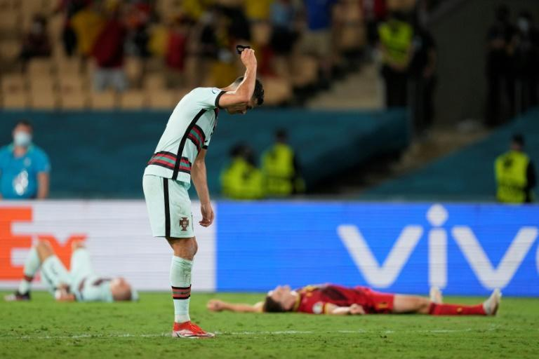Portugal's Cristiano Ronaldo threw his captain's armband on the ground after the Belgium loss