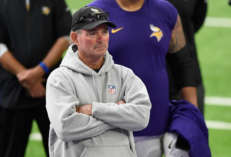 Mike Zimmer with his arms crossed on the field.
