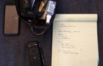 A notepad displays the home workout routine of Christian Hainds, Monday, June 7, 2021, in Hammond, Ind. Health officials have warned since early on in the pandemic that obesity and related conditions such as diabetes were risk factors for severe COVID-19. It wasn't until he was diagnosed as diabetic around the start of the pandemic that he felt the urgency to make changes. Hainds lost about 50 pounds during the pandemic, and at 180 pounds and 5 feet, 11 inches tall is no longer considered obese. (AP Photo/Shafkat Anowar)