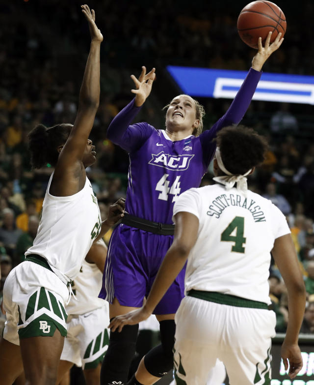 Baylor's Queen Egbo, left, and Honesty Scott-Grayson (4) defend as Abilene Christian forward Lexie Ducat (44) takes a shot in the first half of a first-round game in the NCAA womens college basketball tournament in Waco, Texas, Saturday March 23, 2019. (AP Photo/Tony Gutierrez)