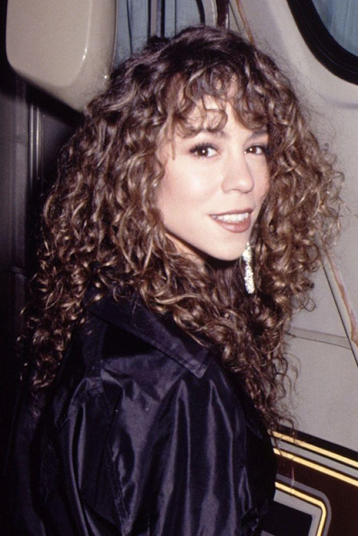 <p>Mariah grew up and kicked off her storied career with medium-brown curls.</p>
