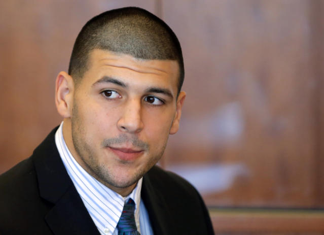 FILE - In this Oct. 9, 2013 file photo, former New England Patriots NFL football player Aaron Hernandez attends a pretrial court hearing in Fall River, Mass. Hernandez has pleaded not guilty in the killing of 27-year-old Odin Lloyd, a semi-professional football player from Boston who was dating the sister of Hernandez's girlfriend. On Monday, Dec. 16, 2013, Lloyd's family filed a wrongful death suit against Hernandez in court in New Bedford, Mass. (AP Photo/Brian Snyder, Pool, File)