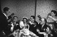 <p>In this 1952 wedding, guests didn't have to go far to find a glass to raise in celebration of the happy couple because the festivities took place at a pub.</p>