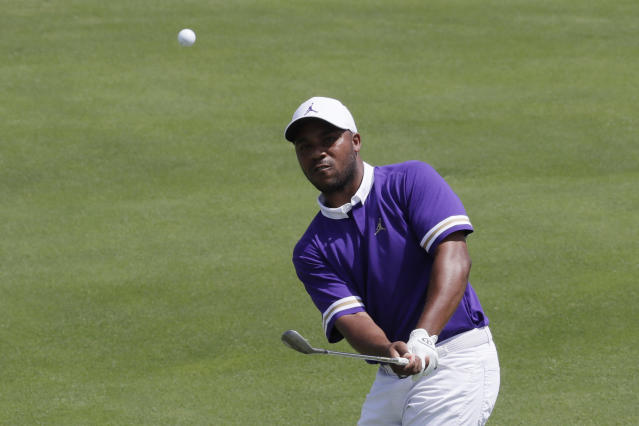 Harold Varner III hits from the third fairway in the final round of the Northern Trust golf tournament at Liberty National Golf Course, Sunday, Aug. 11, 2019 in Jersey City, N.J. (AP Photo/Mark Lennihan)