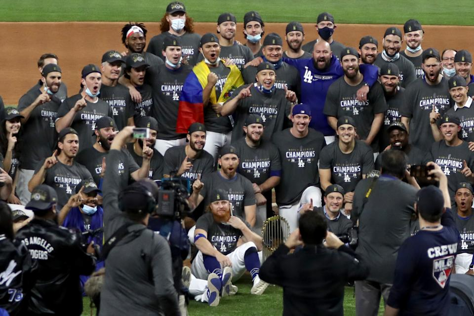 ARLINGTON, TEXAS - OCTOBER 27:  The Los Angeles Dodgers pose for a photo after defeating the Tampa Bay Rays 3-1 in Game Six to win the 2020 MLB World Series at Globe Life Field on October 27, 2020 in Arlington, Texas. (Photo by Ronald Martinez/Getty Images)