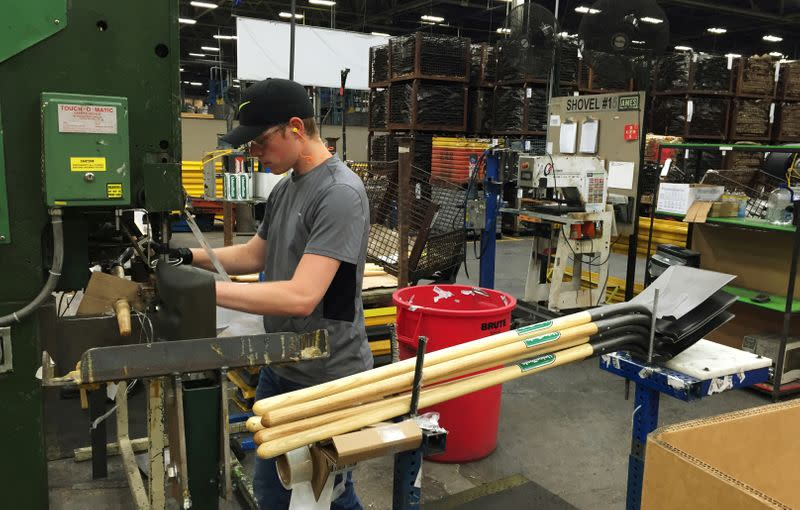 FILE PHOTO: A production line employee works at the AMES Companies shovel manufacturing assembly line in Camp Hill