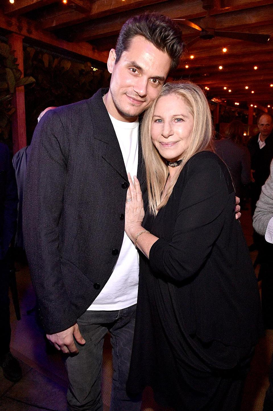 <p>The friends embraced at her 75th birthday bash Monday, held at Cafe Habana in Malibu, Calif. Babyface, Cindy Crawford (with husband, Rande Gerber, an investor in the restaurant), and Pierce Brosnan were also at the star-studded soirée. (Photo: Kevin Mazur/WireImage) </p>