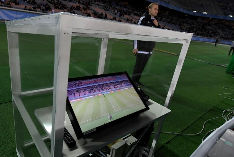 The video assistant referee system is placed beside the pitch prior to the Club World Cup semi-final football match between Mexico's Club America and Spain's Real Madrid at Yokohama International stadium in Yokohama on December 15, 2016