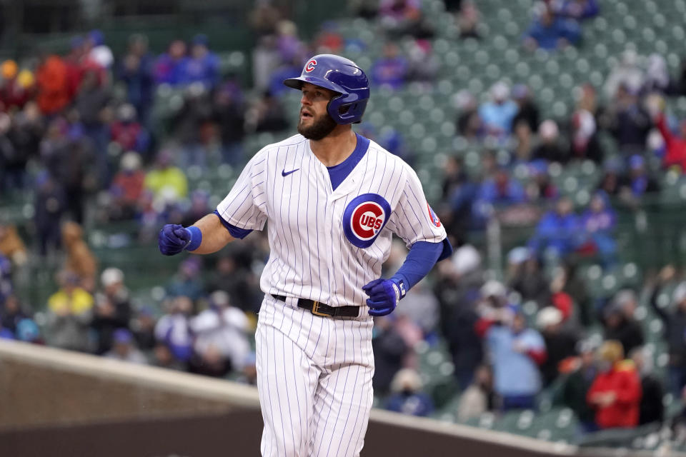 Chicago Cubs' David Bote looks at the left field bleachers where his home run landed off Cincinnati Reds starting pitcher Vladimir Gutierrez in the fifth inning of a baseball game Friday, May 28, 2021, in Chicago. (AP Photo/Charles Rex Arbogast)